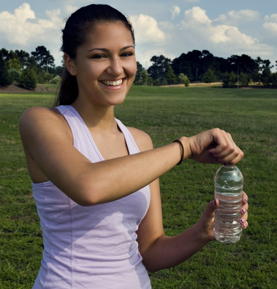 a-young-woman-drinking-bottled-water-
